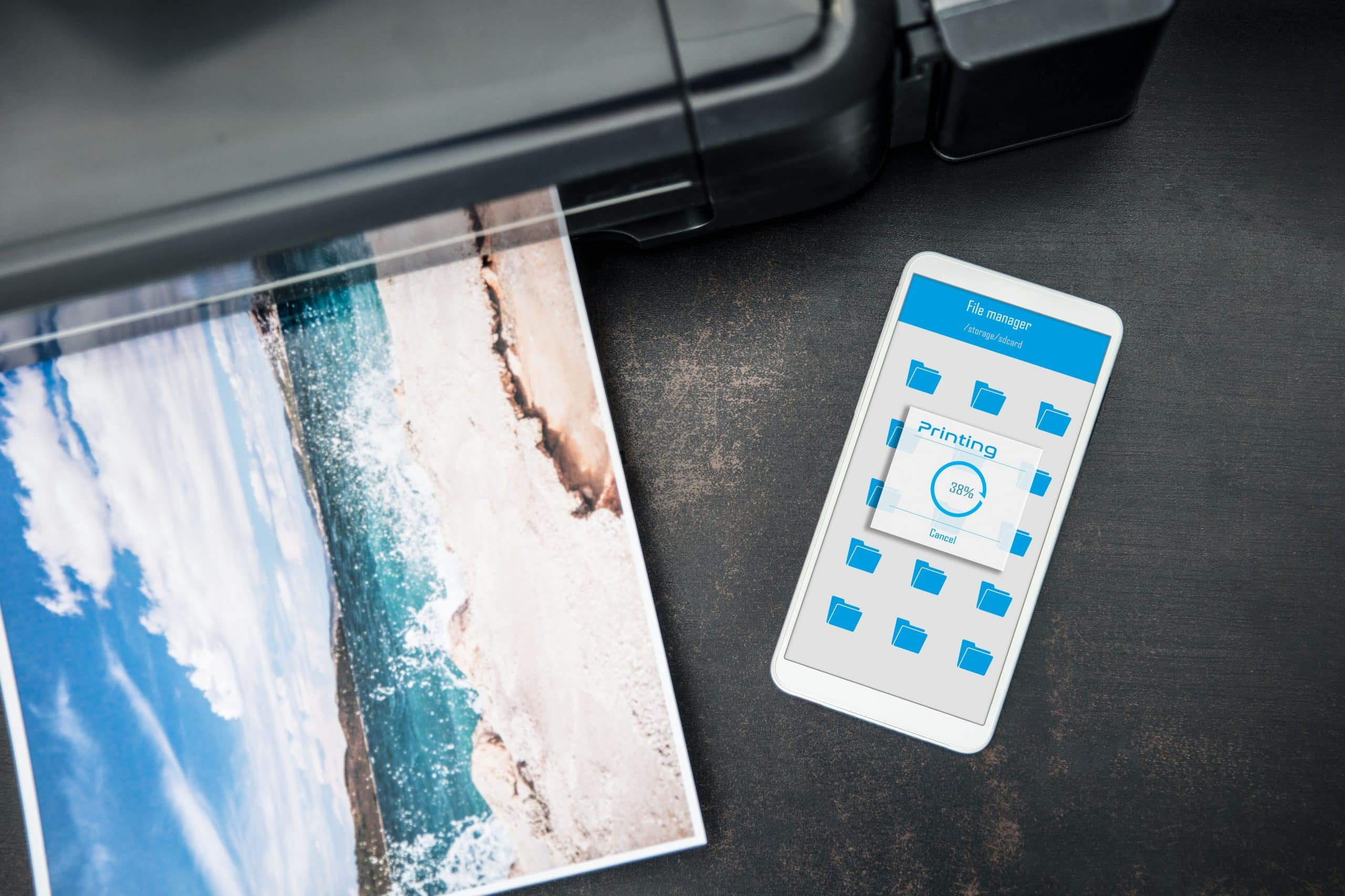 smartphone connected to the wireless printer is laying on the desk 945226682 5af5d58e6bf0690036a2fa13 scaled