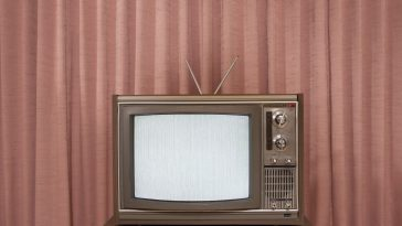 old television on stand in front of curtain 200453943 001 59baf29e6f53ba001047b17f