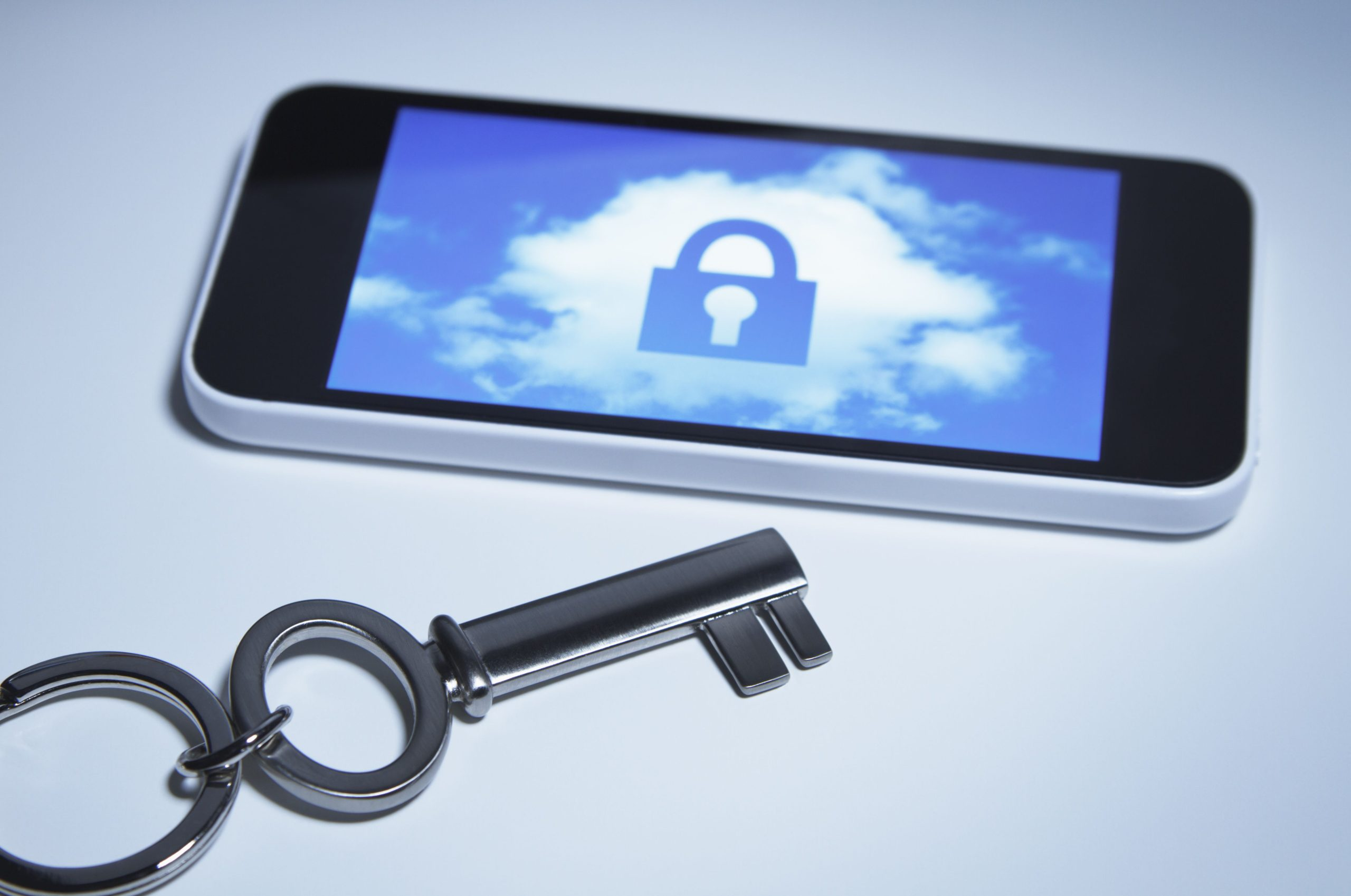 secure smart phone a key next to smartphone with a lock over a cloud on its screen 499133405 5b2718cd43a10300374a9680 scaled